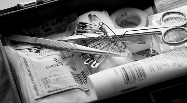 Survival First Aid Kit detail in black and white