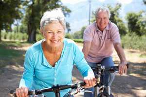 elderly couple riding bikes