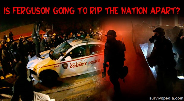 Street riots in Ferguson with police car being assaulted