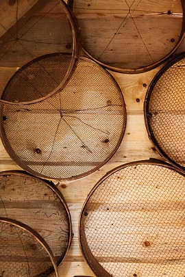 strainers on wood wall