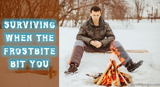 Man warming over a campfire in snow