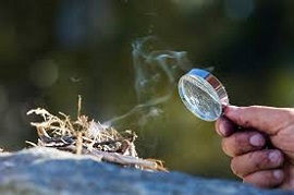 Making fire with a magnifying glass
