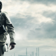 man in postapocalyptic landscape wit survival gear and gas mask