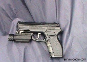 pistol with an attached TAC-Light