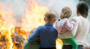 32320556 - family of mother with children at burning house background