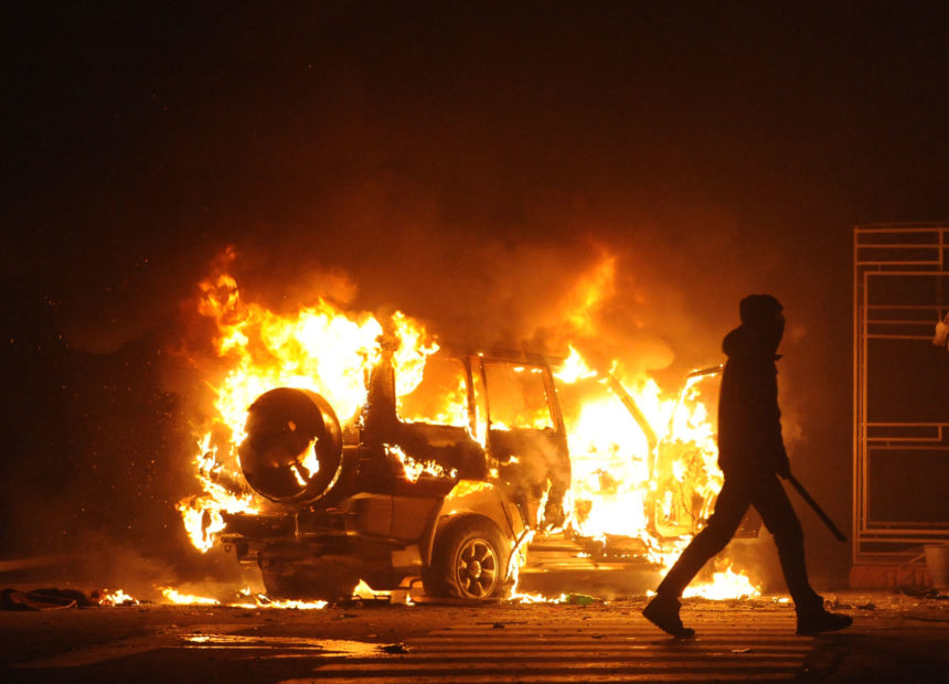 83289047 - burning car, unrest, anti-government, crime