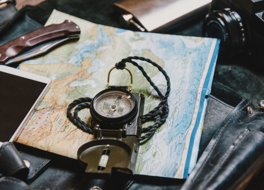 83075160 - equipment for tourism and travel. map and compass.